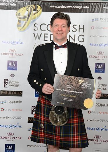 Piper On Parade with Award at the Scottish Wedding Awards